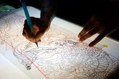 Horitamotsu drawing a dragon stencil